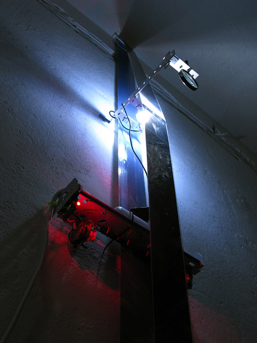 A Single Composite [vert] (2011), acetate film, aluminum, glass, motors, electronic components, LEDs, satellite photographs